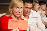 Audience member presenting tickets — Stock Photo
