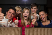 Happy in movie theatre — Stock Photo
