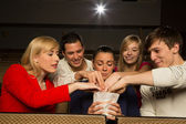 Stealing popcorn in cinema — Stock Photo