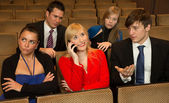 Woman in the audience annoying others with a cellphone — Stock Photo