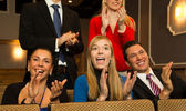 Theatre audience clapping and cheering — Stok fotoğraf