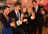 Group of friends celebrating — Stock Photo