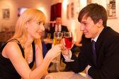 Couple in love enjoying drinks — Stock Photo