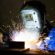 ������, ������: Man welding steel creating many sparks