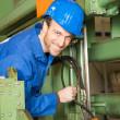 Engineer repairing a machine - Stock Photo