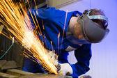 Trabajador de la construcción con amoladora angular — Foto de Stock