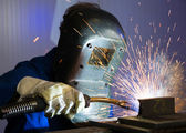 Man welding steel creating many sparks — Stock Photo