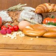 Kitchen table with a lot of food like bread and vegetables — Stock Photo