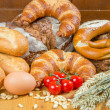 Different types of Bread and tomatoes - Stock Photo