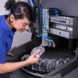 Technician in a dental lab working at a drilling or milling machine — Stockfoto