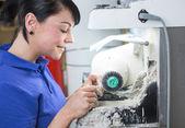 Dental technician polishing a prosthesis — Stock Photo