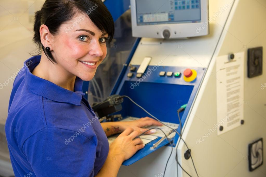 Technician in a dental lab working at a drilling or milling ...