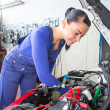 Car mechanic repairing a automobile - Stock Photo