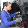 Car mechanic repairs the brakes - Stockfoto
