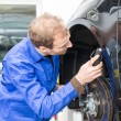 Car mechanic repairs the brakes — Stock Photo #22997894