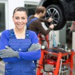 Female mechanic standing in a garage — Stock Photo