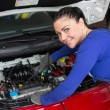 Mechanic repairing a car in a workshop or garage - Foto Stock