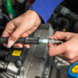 Car mechatronic technician spark plugs - Stock Photo