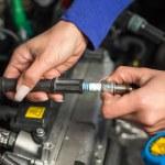 Car mechatronic technician spark plugs — Stock Photo