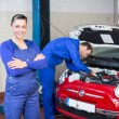 Car mechanic in garage or workshop — Stock Photo #22998278