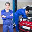Car mechanic in garage or workshop — Stock Photo #22998280