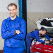 Car mechanic in garage or workshop — Stock Photo #22998312