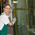 Glazier in workshop handling glass — Stock Photo