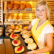 Stock Photo: Bakery shopkeeper with cake or pastry