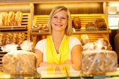 Bakery shopkeeper posing in shop — Stock Photo