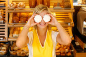 Bakery shopkeeper covers eyes with meringue — Stock Photo
