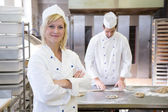 Baker posing in bakery or bakehouse — Stock Photo