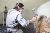 Car body painter spraying paint on bodywork parts — Стоковое фото