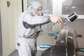 Car body painter spraying paint on bodywork parts — Stock Photo