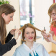 Royalty-Free Stock Photo: Hairdressers cutting customers hair in salon