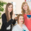 Hairdresser dying hair of client — Stock Photo