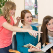 Two hairstylists consult customer — Stock Photo #25095455