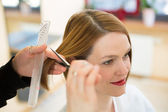 Closeup of hairdresser cutting hair — Stock Photo