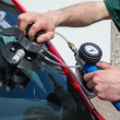 Stock Photo: Glazier repairing windscreen after stone chipping damage