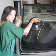 Glazier replacing windshield — Stock Photo