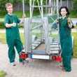 Stock Photo: Glazier with glass transportion trailer
