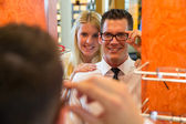 Couple in optician's shop trying spectacle frame — Stok fotoğraf
