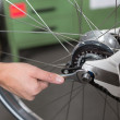Closeup of the hands of bicycle mechanic at work — Stock Photo #27585399