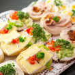 Постер, плакат: Sandwiches with cold cuts on a tray