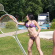 Couple playing badminton at swimming poot or park — Stock Photo #30562831
