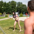 Couple playing badminton at swimming poot or park — Stock Photo