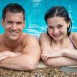 Couple enjoying themselves at public swimming pool — Stock Photo