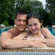 Couple enjoying holidays at pool edge  — Lizenzfreies Foto