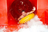 Man in waterslide at public swimming pool — Foto Stock