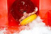 Man in waterslide at public swimming pool — Foto de Stock