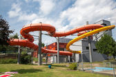 Water slide tube at public swimming pool — Stock Photo